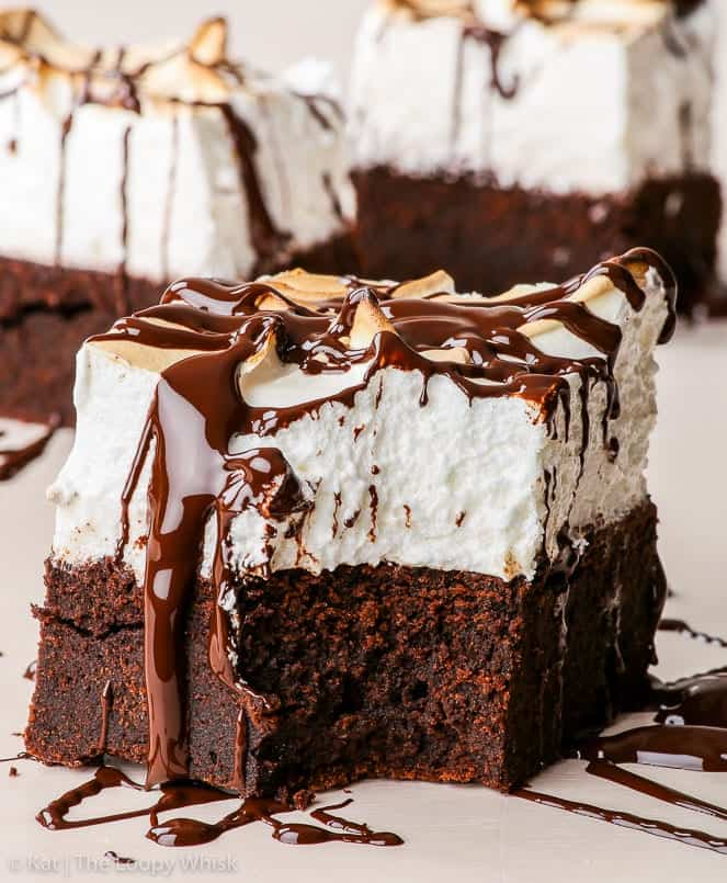 Marshmallow brownies topped with chocolate sauce.